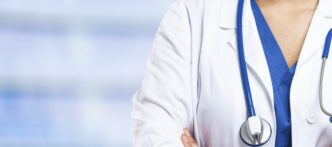 Detail of a nurse uniform on a blue blurred background